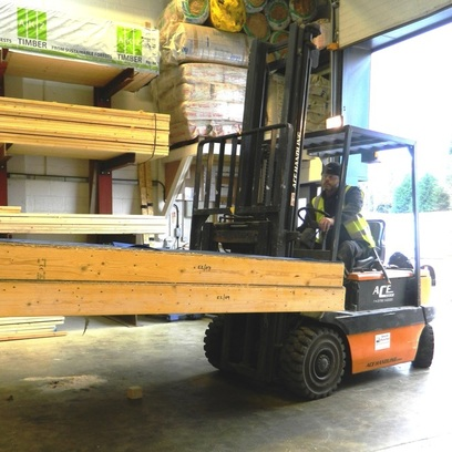 forklift carrying a timber frame