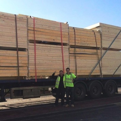 timber frames on the back of a lorry
